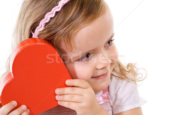 Little girl checking a present Stock photo © lightkeeper