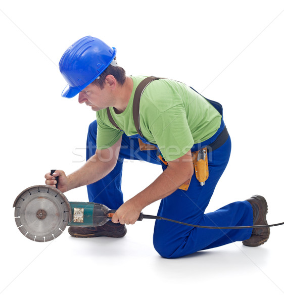 Worker with a power grinder Stock photo © lightkeeper