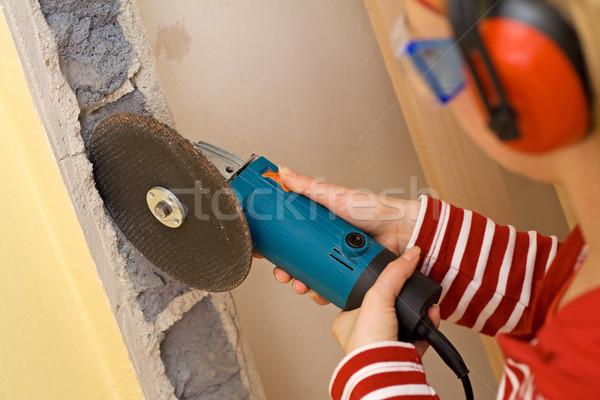 Csináld magad nő daráló perem fal nők Stock fotó © lightkeeper