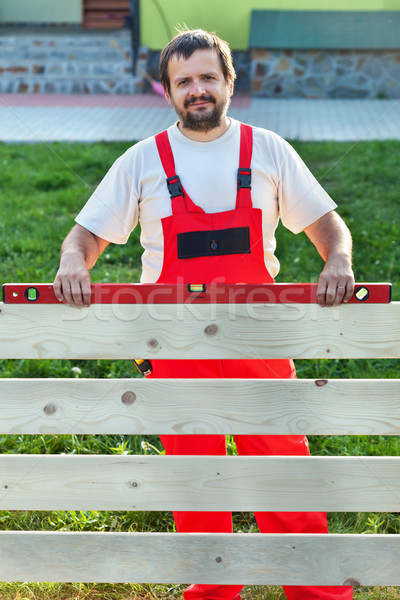 Handyman building a wooden fence Stock photo © lightkeeper