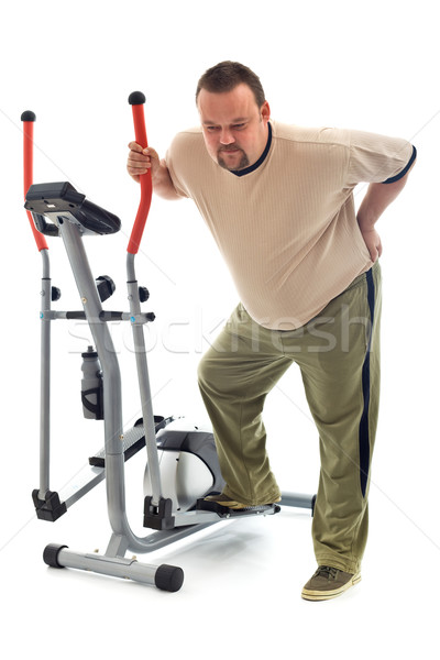 Man with back ache near a training device Stock photo © lightkeeper