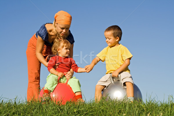 Family outdoors playing together Stock photo © lightkeeper