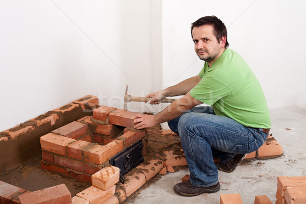 Worker building a brick stove Stock photo © lightkeeper