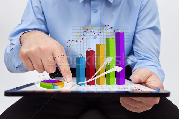 Businessman working on annual report - closeup on charts Stock photo © lightkeeper