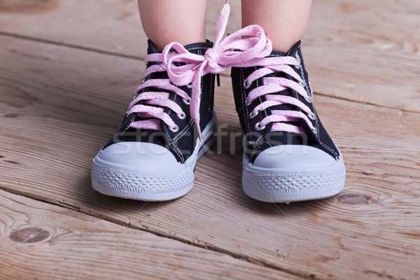 Partial success - child tied two shoes together Stock photo © lightkeeper