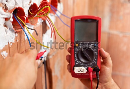 Electrician hands with multimeter - closeup Stock photo © lightkeeper