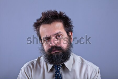 Exhausted man with bushy hair and beard Stock photo © lightkeeper