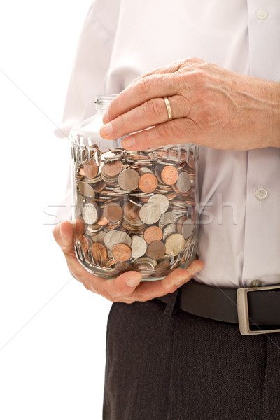 Senior hands holding jar with lots of coins Stock photo © lightkeeper