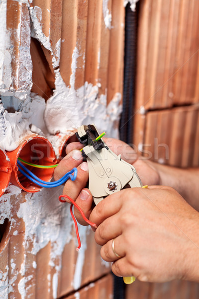 Electrician hands at work Stock photo © lightkeeper