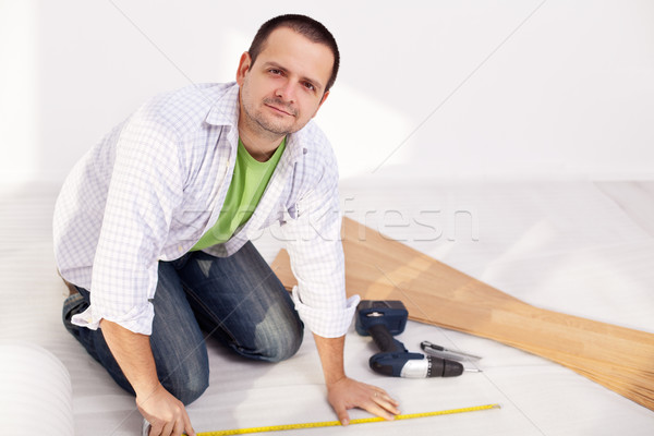 Man preparing to lay some laminate floor planks Stock photo © lightkeeper