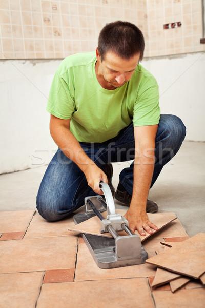 Man cutting ceramic floor tiles Stock photo © lightkeeper