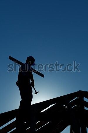 Builder working late on top of building Stock photo © lightkeeper