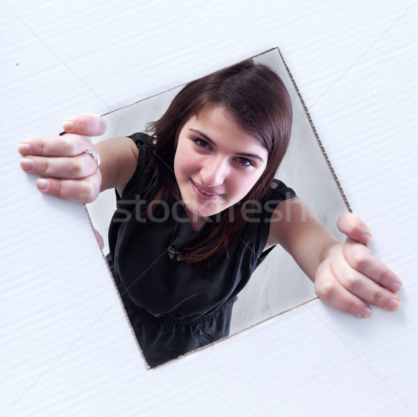 Teenager crawling and peeking out of a hole Stock photo © lightkeeper
