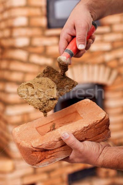 Building a masonry heater - closeup on worker hands Stock photo © lightkeeper