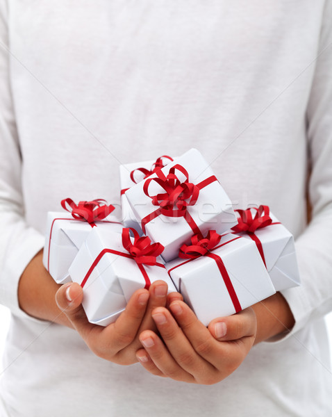 Christmas presents in child hands Stock photo © lightkeeper