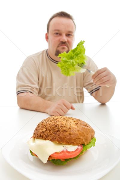 Dieta uomo mangiare lattuga dietro Foto d'archivio © lightkeeper