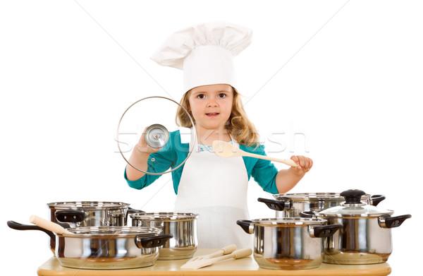 Kislány játszik főzés kellékek visel szakács sapka Stock fotó © lightkeeper