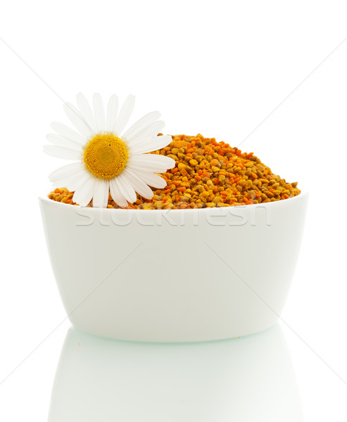 Pollen in a bowl with daisy Stock photo © lightkeeper