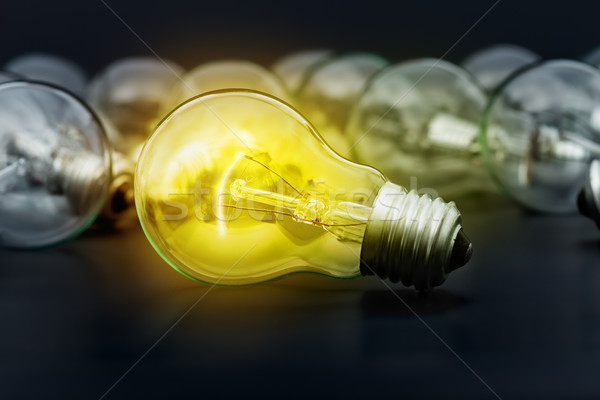 Stock photo: Idea concept with incandescent light bulbs