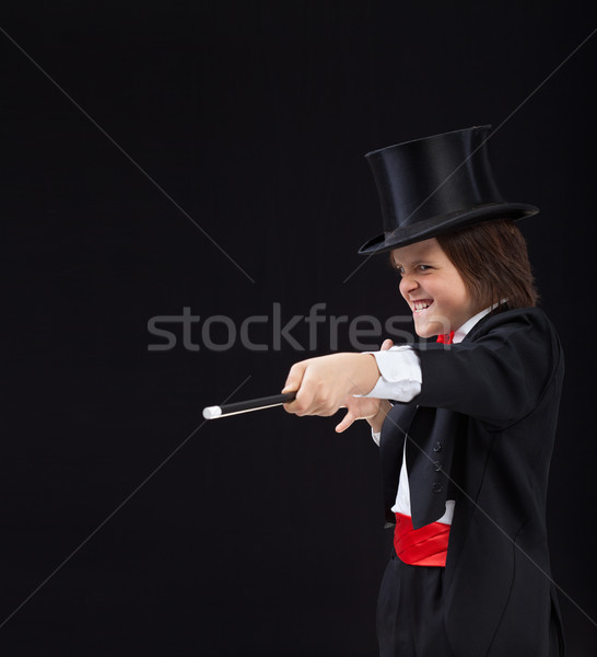 Stock photo: Magician boy with hardhat pointing to copy space with magic wand