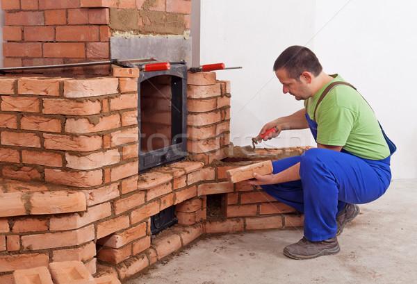 Trabalhador edifício alvenaria aquecedor fogo Foto stock © lightkeeper