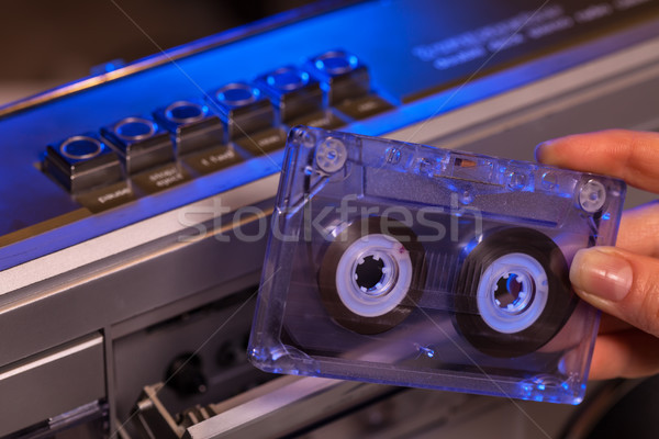 Hand holding compact audio cassette tape - closeup Stock photo © lightkeeper
