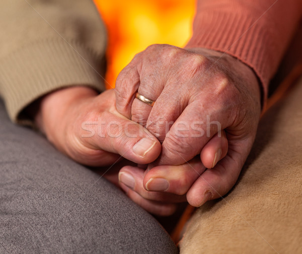 Senior hands of man and woman holding Stock photo © lightkeeper