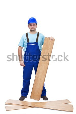 Worker with laminate flooring Stock photo © lightkeeper
