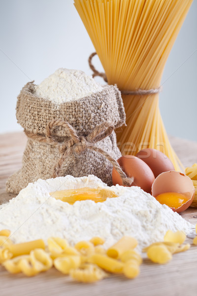 Ingredients for making pasta - flour and eggs Stock photo © lightkeeper