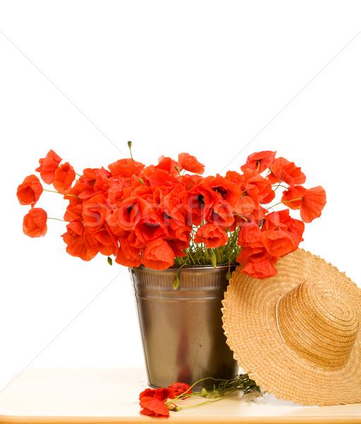 красный мак цветы металлический ковша соломенной шляпе Сток-фото © lightkeeper