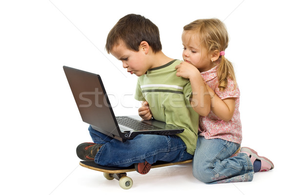 Children rival for using the laptop Stock photo © lightkeeper