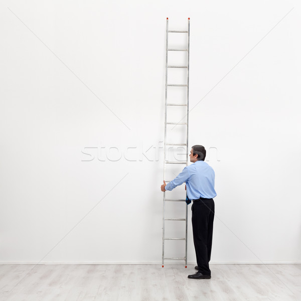 The corporate ladder - businessman at the start of carrier  Stock photo © lightkeeper