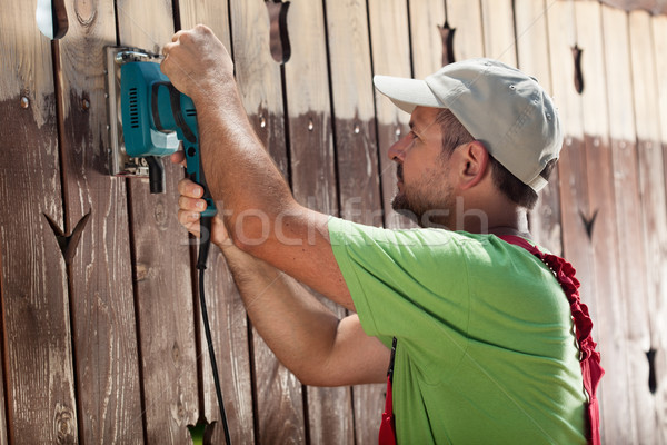 Worker with vibrating sander Stock photo © lightkeeper