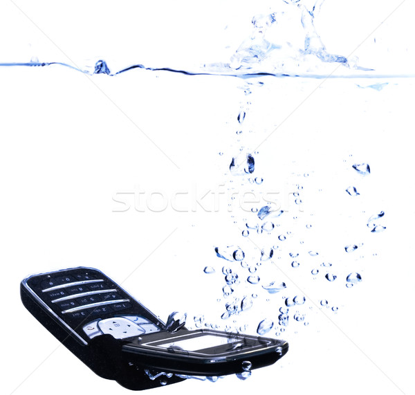 Phone splashing into water - high key Stock photo © lightkeeper