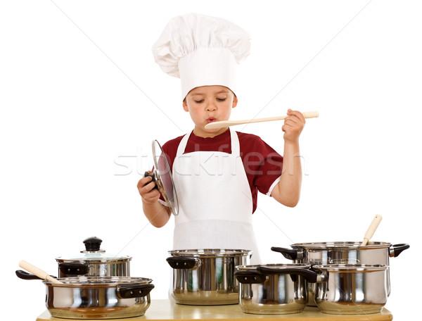 Fiú szakács sapka játszik főzés kellékek szakács Stock fotó © lightkeeper