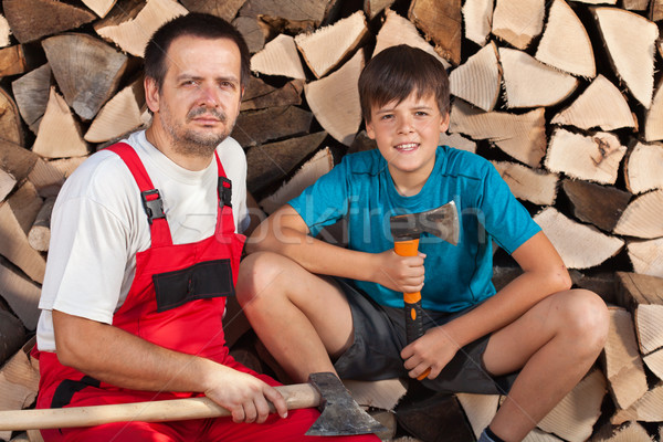 Man and boy sitting together in front of chopped wood Stock photo © lightkeeper