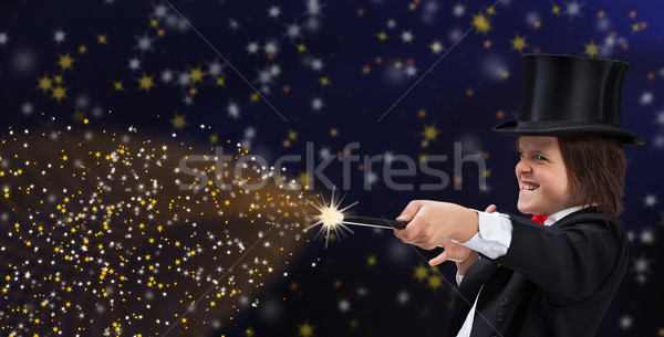 Magician boy with hardhat pointing to copy space with magic wand Stock photo © lightkeeper