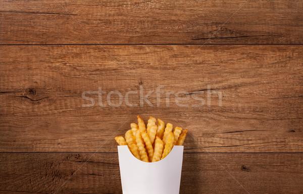 Frytki torby papierowe brązowy drewniany stół kopia przestrzeń Zdjęcia stock © lightkeeper