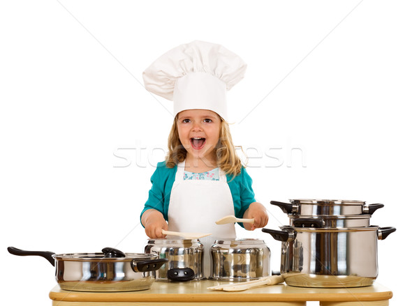 Happy little girl with chef hat making noise with the cooking po Stock photo © lightkeeper