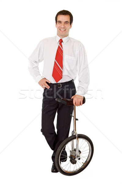 Balance in business - businessman with monocycle Stock photo © lightkeeper