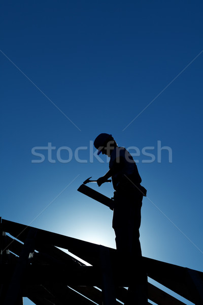 Worker on the roof structure in backlight Stock photo © lightkeeper