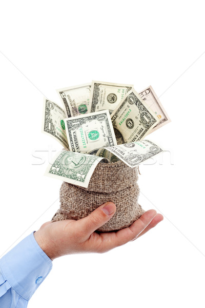 Opportunity presented - sack of money offered by male hand Stock photo © lightkeeper