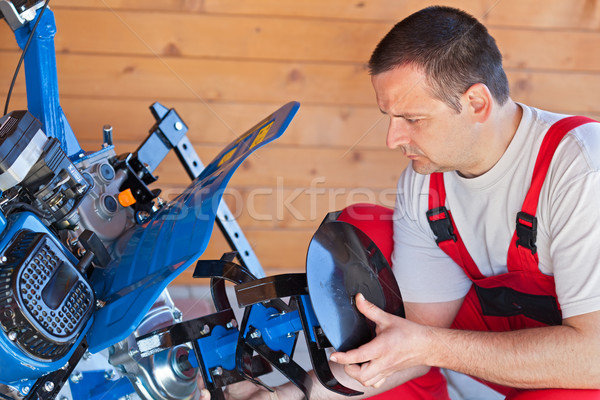 Man installing tilling accessory on agricultural machine Stock photo © lightkeeper