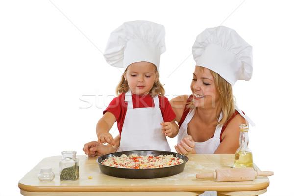 Girls preparing pizza Stock photo © lightkeeper