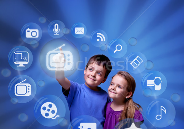 Kids accessing modern entertainment applications from the cloud Stock photo © lightkeeper