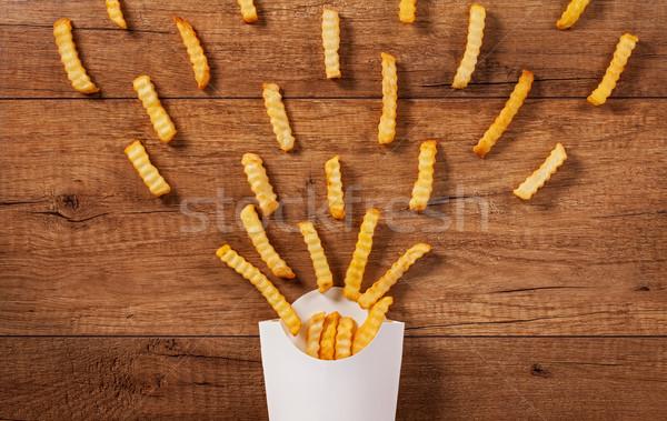 Patates kızartması dışarı kâğıt çanta fast-food kahverengi Stok fotoğraf © lightkeeper