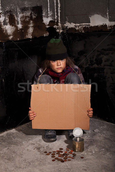 Poor beggar child on the street with blank sign Stock photo © lightkeeper