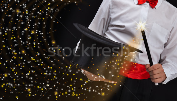Magician hands with sparkling stars Stock photo © lightkeeper