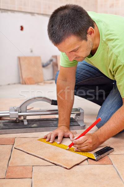 Worker installs ceramic tiles Stock photo © lightkeeper