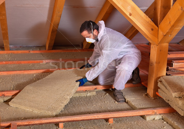 Man laying thermal insulation Stock photo © lightkeeper